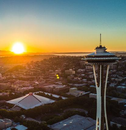 the Seattle space needle and skyline at sunset